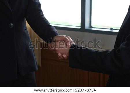 businesswomen Handshake #520778734