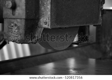 Industrial surface grinding machine. Black-and-white photo. #520817356