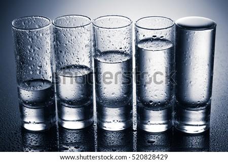 A row of glasses for vodka. studio shot #520828429