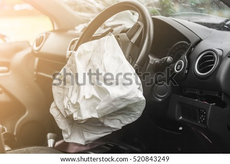 Airbag exploded at a car accident with illuminated Royalty-Free Stock Photo #520843249