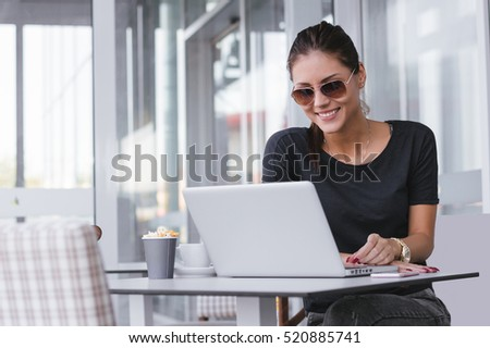 Young business woman with laptop #520885741