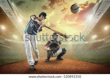 Baseball players in action on the stadium. #520892350