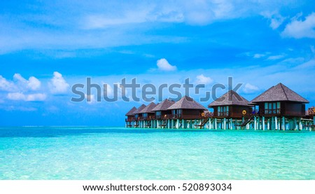 beach with water bungalows at Maldives #520893034