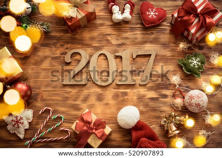 Christmas tree decorations on wooden table. Xmas New Year Holiday concept. Numbers 2017 #520907893