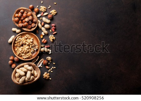 Various nuts on stone table. Top view with copy space #520908256