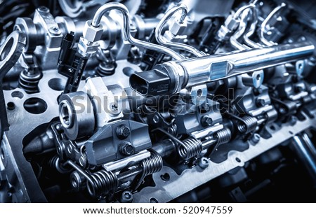 The powerful engine of a car. Internal design of engine. Car engine part. Modern powerful car engine. #520947559
