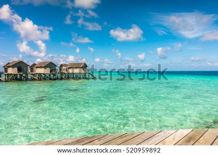 Beautiful tropical Maldives resort hotel with beach and blue water #520959892