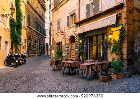 View of old cozy street in Rome, Italy. Architecture and landmark of Rome. Postcard of Rome. Royalty-Free Stock Photo #520976350