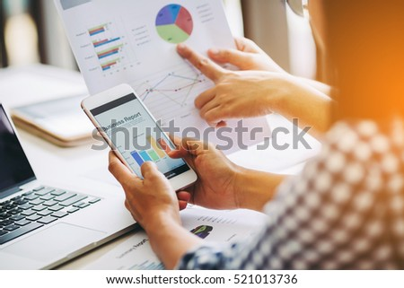 Two business woman investment consultant analyzing company annual financial report balance sheet statement working with documents graphs. Concept picture of economy, market, office,money and tax.
