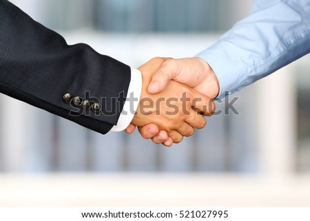 Successful business people shaking hands  at the meeting #521027995
