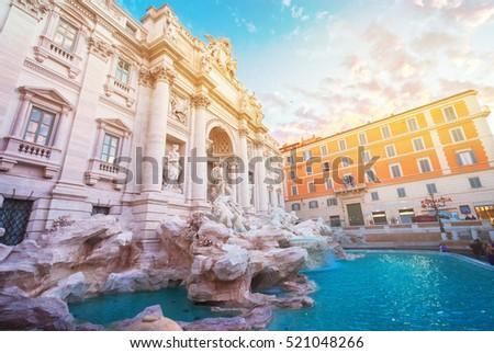 restored Fountain di Trevi in Rome in sunrise light with sunshine, Italy #521048266