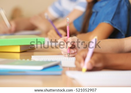 Children hands writing in copybooks, closeup #521052907
