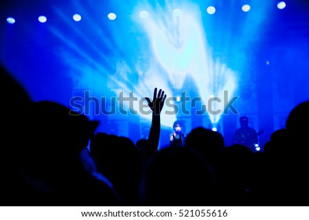 crowd at concert and bright stage lights #521055616