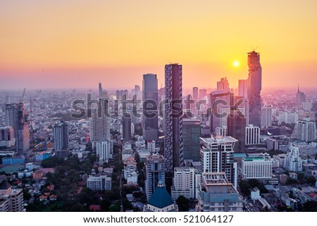 Sunset in megapolis. Beautiful cityscape with top view on skyscrapers. Bangkok, Thailand. #521064127