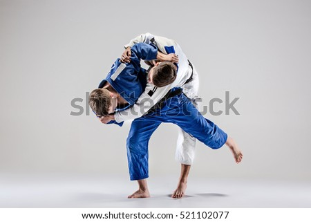 The two judokas fighters fighting men Royalty-Free Stock Photo #521102077