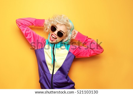 Fashion girl in sportswear on yellow background #521103130