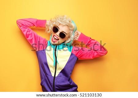 Fashion girl in sportswear on yellow background #521103130