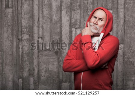 emotional closeup of Santa like man face in sportswear in studio