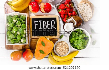 High Fiber Foods on a wooden background. Flat lay Royalty-Free Stock Photo #521209120