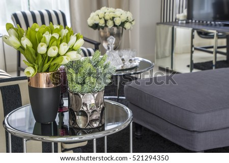 plastic flowers in pink flower vase on the rattan weave table decorated interior in living room #521294350