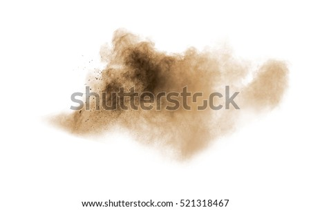 Abstract brown powder splattered on white background.Abstract design of color dust cloud against white background. Royalty-Free Stock Photo #521318467