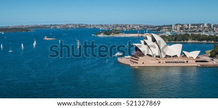Circular Quay business district in Sydney Australia with a ferry entering the harbor Royalty-Free Stock Photo #521327869