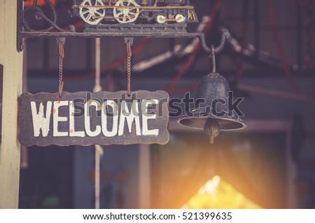 grunge metal welcome sign hanging. selective focus.
