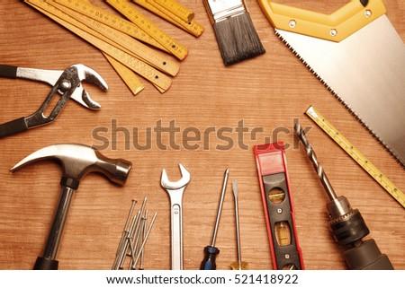 Assorted work tools on wood #521418922