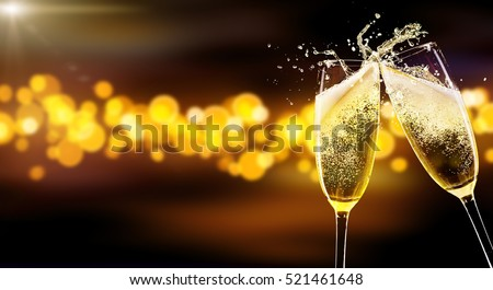 Two glasses of champagne over blur spots lights background. Celebration concept, free space for text #521461648
