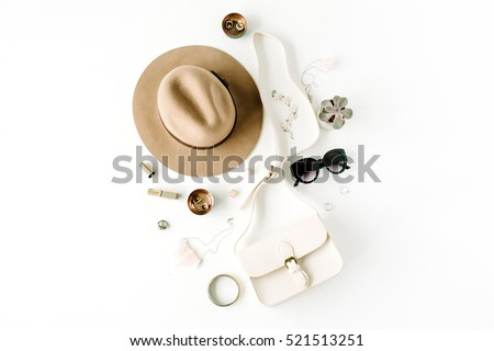 Flat lay trendy creative feminine accessories arrangement. Purse, hat, sunglasses, female accessories. Top view Royalty-Free Stock Photo #521513251