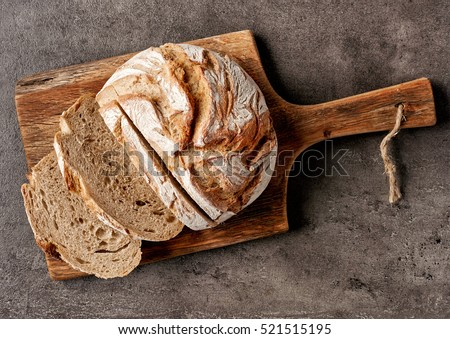 freshly baked bread on dark gray kitchen table, top view #521515195