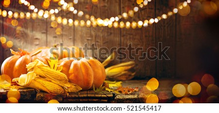 Happy Thanksgiving Day background, wooden table decorated with Pumpkins, Corncob, Candles and autumn leaves garland. Beautiful Holiday Autumn festival concept scene Fall, Harvest