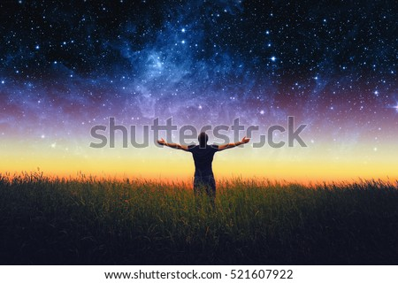 Silhouette of man and stars sky. Elements of this image furnished by NASA Royalty-Free Stock Photo #521607922