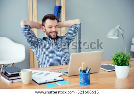 Young happy worker having break and resting after solving task #521608615
