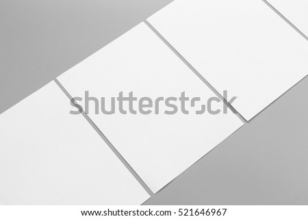 Blank portrait A4. brochure magazine isolated on gray, changeable background / white paper isolated on gray Royalty-Free Stock Photo #521646967