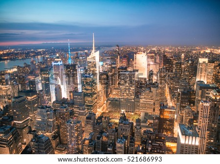 Lights of Manhattan at night in autumn, aerial view of New York City. #521686993