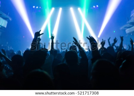 Effects blur Concert, disco dj party. People with hands up having fun  #521717308