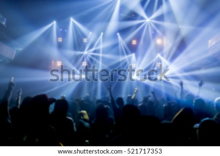 Effects blur Concert, disco dj party. People with hands up having fun  #521717353