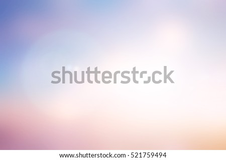 Blurry colorful sunset background with bright light:blur image picture wallpaper concept. Royalty-Free Stock Photo #521759494
