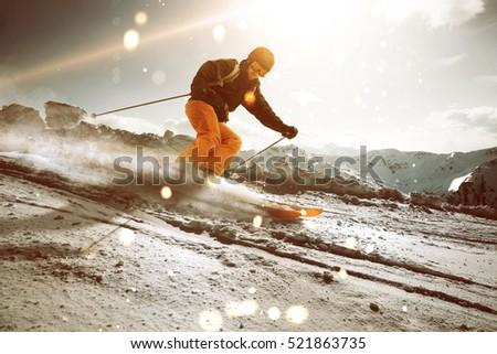 Skier during sunset #521863735