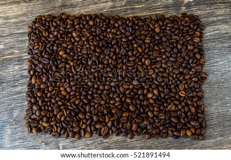Coffee beans on old wooden background. #521891494