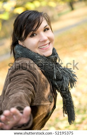 attractive brunette woman happy at park #52195375