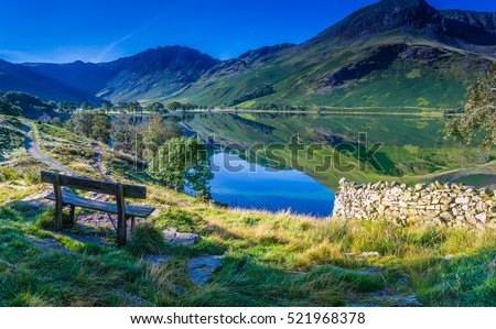 Rest for a moment at Buttermere, The Lake District, Cumbria, England Royalty-Free Stock Photo #521968378