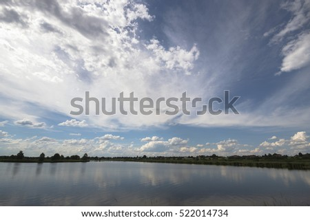 blue lake with cloudy sky, nature series #522014734