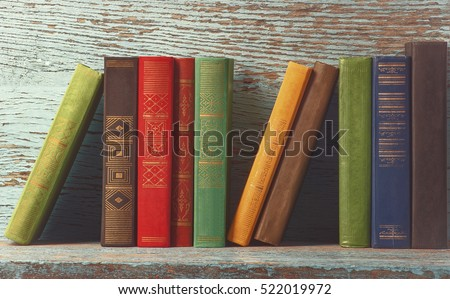 old books on the background of a wooden  #522019972
