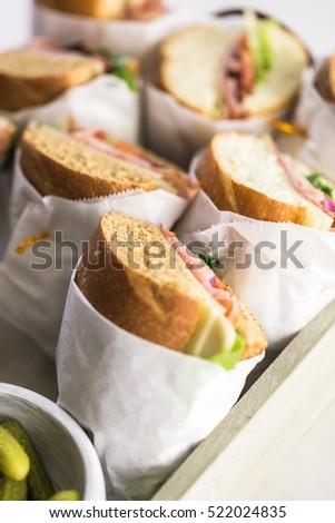 Fresh sub sandwich on white and wheat hoagies. #522024835