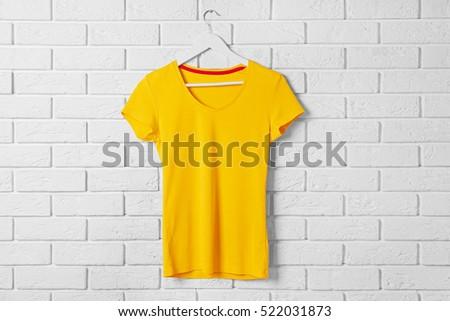 Blank yellow t-shirt against brick wall #522031873