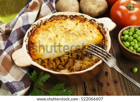 Cottage pie with meat and green peas #522066607