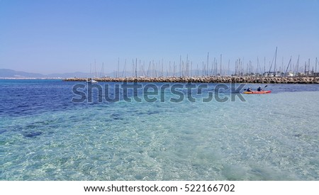 Beautiful sea views with boats, yachts and Palma de Mallorca on the horizon, L'Arenal, Majorca, Balearic Islands, Spain #522166702
