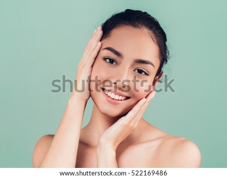 Beauty Woman face Portrait. Beautiful Spa model Girl with Perfect Fresh Clean Skin. Brunette female looking at camera and smiling. Youth and Skin Care Concept. #522169486